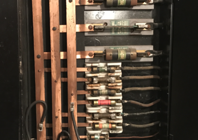 Soldered bar in place of a fuse - Violation - New York Electrical Inspection Agency